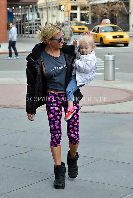 WWW.ACEPIXS.COM<br /> <br /> April 3 2014, New York City<br /> <br /> Celebrity trainer Tracy Anderson walks with her baby Penelope on April 3 2014 in New York City<br /> <br /> By Line: Curtis Means/ACE Pictures<br /> <br /> <br /> ACE Pictures, Inc.<br /> tel: 646 769 0430<br /> Email: info@acepixs.com<br /> www.acepixs.com