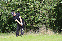 Scott Henry (SCO) plays his 2nd shot from the trees on the 17th hole during Sunday's Final Round of the Northern Ireland Open 2018 presented by Modest Golf held at Galgorm Castle Golf Club, Ballymena, Northern Ireland. 19th August 2018.<br /> Picture: Eoin Clarke | Golffile<br /> <br /> <br /> All photos usage must carry mandatory copyright credit (&copy; Golffile | Eoin Clarke)
