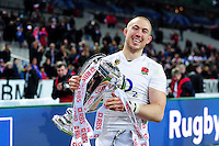 Mike Brown of England is all smiles with the Six Nations trophy. RBS Six Nations match between France and England on March 19, 2016 at the Stade de France in Paris, France. Photo by: Patrick Khachfe / Onside Images
