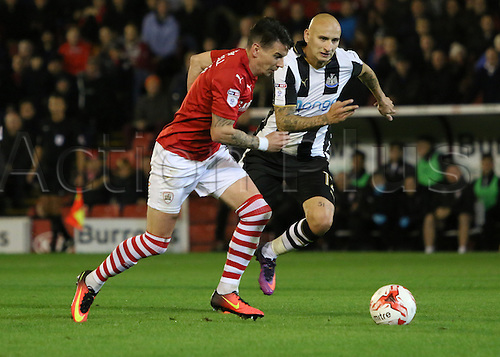 18.10.2016. Oakwell, Barnsley, England. Skybet Championship Football. Barnsley versus Newcastle. Barnsley's Adam Hammill runs with the ball chased by Shelvey