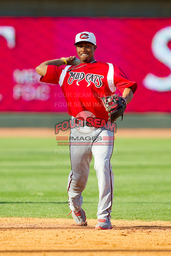 Carolina Mudcats shortstop Francisco Lindor (12) makes a throw to first base during fielding practice prior to the game against the Winston-Salem Dash at BB&T Ballpark on April 13, 2013 in Winston-Salem, North Carolina.  The Dash defeated the Mudcats 4-1.  (Brian Westerholt/Four Seam Images)