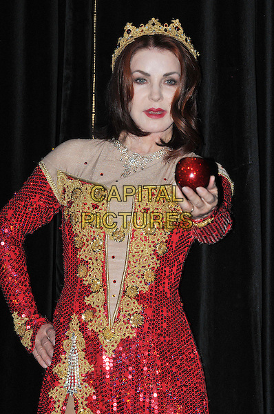 Priscilla Presley.Press launch to star in New Wimbledon Theatre's annual pantomime offering 'Snow White and the Seven Dwarfs' at The Savoy, Strand, London, England..September 26th, 2012.panto costume half length gold red dress crown sequins sequined apple  hand on hip.CAP/BF.©Bob Fidgeon/Capital Pictures.