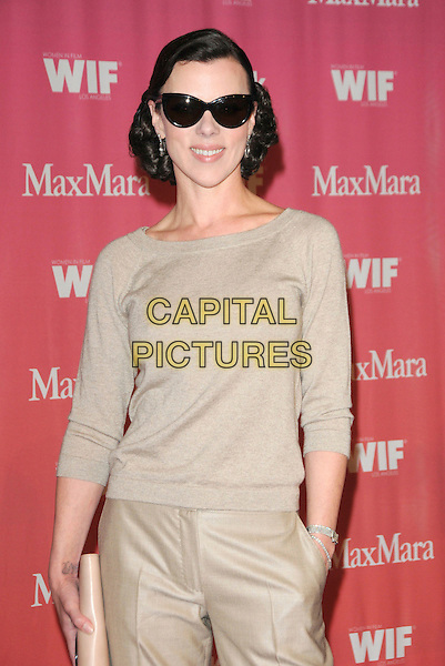 DEBI MAZAR .at The Women in Film 2009 Crystal .and Lucy Awards held at The Hyatt Regency Century Plaza in Century City, California, USA, June 12th 2009                                                                     .half length beige trousers jumper top clutch bag sunglasses .CAP/DVS.©Debbie VanStory/RockinExposures/Capital Pictures