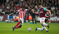 Mame Biram Diouf of Stoke City n& Declan Rice of West Ham United during the Premier League match between West Ham United and Stoke City at the Olympic Park, London, England on 16 April 2018. Photo by Andy Rowland.