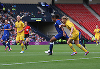 Women's Olympic Football match France v Sweden on 3.8.12...Annica Svensson of Sweden and Marie-Laure Delie of France, during the Women's Olympic Football match between France v Sweden at Hampden Park, Glasgow...........