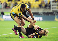 Ngani Laumape tackles Chiefs flyhalf Damien McKenzie into touch during the Super Rugby match between the Hurricanes and Chiefs at Westpac Stadium in Wellington, New Zealand on Friday, 13 April 2018. Photo: Dave Lintott / lintottphoto.co.nz