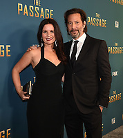 "SANTA MONICA - JANUARY 10: Henry Ian Cusick and Annie Wood attends the red carpet premiere party for FOX's ""The Passage"" at The Broad Stage on January 10, 2019, in Santa Monica, California. (Photo by Frank Micelotta/Fox/PictureGroup)"
