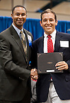 Dr. Bennie Lambert congratulates Joshua Brown winner of the Nikki Myers and Cher Brock Endowed Scholarship at the 2011 Aldine Scholarship Foundation Scholarship Ceremony at Lone Star College - North Harris