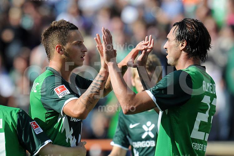 FUSSBALL   1. BUNDESLIGA   SAISON 2010/2011   2. SPIELTAG SV Werder Bremen - 1. FC Koeln      28.08.2010 Marko ARNAUTOVIC (li) und Hugo ALMEIDA (re, beide Bremen) jubeln nach dem 3:1