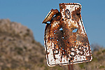 Old and rusy Do Not Pass sign at Tecopa Pass in the Kingston Range of Southern California.
