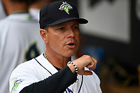 Manager Pedro Lopez (32) of the Columbia Fireflies fist bumps his players before a game against the Augusta GreenJackets on Saturday, April 7, 2018, at Spirit Communications Park in Columbia, South Carolina. Augusta won, 6-2. (Tom Priddy/Four Seam Images)