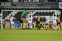 Kristoffer Nordfeldt of Swansea City (in green) punches the ball away from a Sheffield Wednesday cross during The Emirates FA Cup Fifth Round Replay match between Swansea City and Sheffield Wednesday at the Liberty Stadium, Swansea, Wales, UK. Tuesday 27 February 2018