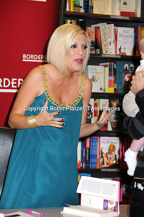 "Tori Spelling in Julie Haas dress.at a book signing for her new book ""sTori Telling"" on .March 11, 2008 at Borders at Time Warner Center..Robin Platzer, Twin Images"