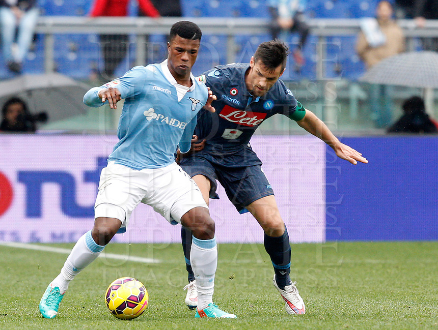 Calcio, Serie A: Lazio vs Napoli. Roma, stadio Olimpico, 18 gennaio 2015.<br /> Lazio&rsquo;s Keita Diao is challenged by Napoli&rsquo; Christian Maggio during the Italian Serie A football match between Lazio and Napoli at Rome's Olympic stadium, 18 January 2015.<br /> UPDATE IMAGES PRESS/Riccardo De Luca