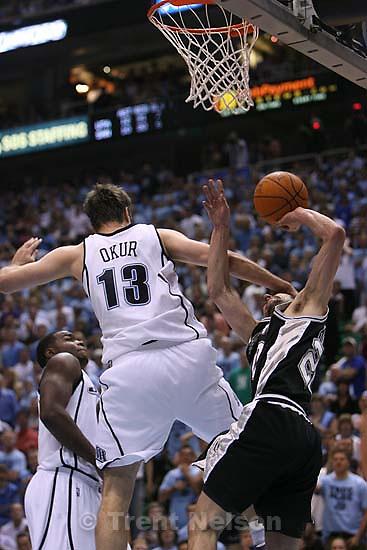 Salt Lake City - Utah Jazz center Mehmet Okur (13) fouls San Antonio Spurs guard Manu Ginobili (20). Utah Jazz vs. San Antonio Spurs, Western Conference Finals game four at EnergySolutions Arena..5.28.2007