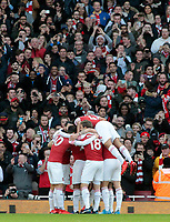 Arsenal's Pierre-Emerick Aubameyang is mobbed after scoring the opening goal in front on the home fans<br /> <br /> Photographer David Shipman/CameraSport<br /> <br /> The Premier League - Arsenal v Burnley - Saturday 22nd December 2018 - The Emirates - London<br /> <br /> World Copyright © 2018 CameraSport. All rights reserved. 43 Linden Ave. Countesthorpe. Leicester. England. LE8 5PG - Tel: +44 (0) 116 277 4147 - admin@camerasport.com - www.camerasport.com