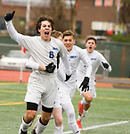 NEW BRITAIN, CT-111817JS01- Lewis Mills' Dylan McCall (8) celebrates his game-winning goal with teammates in their 3-2 win over Suffield to capture the Class M state title Saturday at Willow Brook Park in New Britain.<br /> Jim Shannon Republican-American