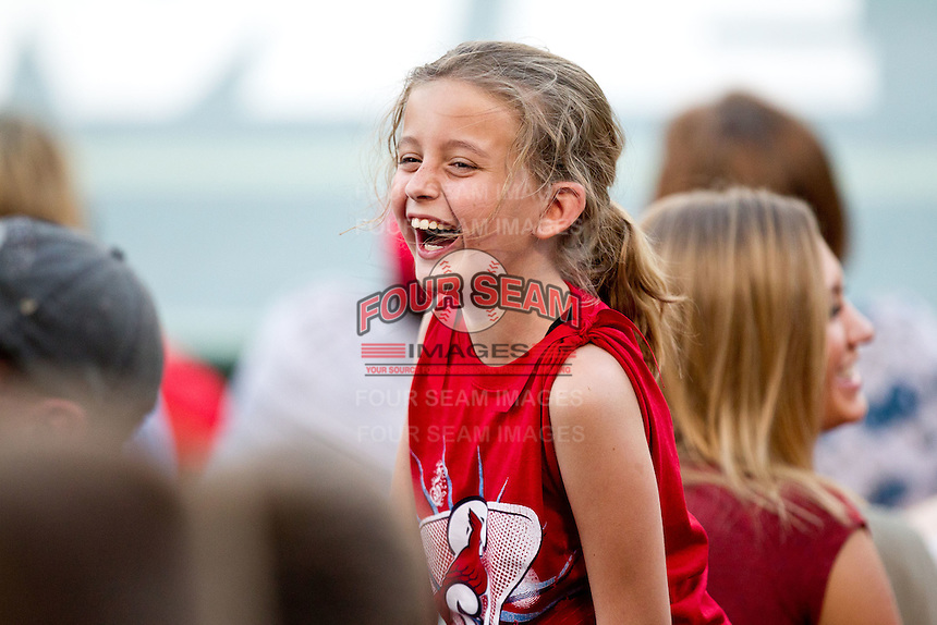 A young Springfield Cardinals fan laughs during a game between the Arkansas Travelers and the Springfield Cardinals at Hammons Field on May 5, 2012 in Springfield, Missouri. (David Welker/Four Seam Images)