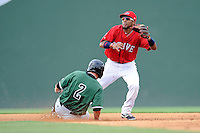 Second baseman Wendell Rijo (11) of the Greenville Drive goes wide to stop a throw from home as Ryan Jones of the Augusta GreenJackets steals second on Sunday, July 13, 2014, at Fluor Field at the West End in Greenville, South Carolina. Rijo is the No. 18 prospect of the Boston Red Sox, according to Baseball America. Greenville won, 8-5. (Tom Priddy/Four Seam Images)