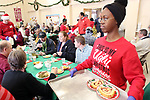 WATERBURY CT. 25 December 2018-122518SV04-Jasmine Walton, 15, of Waterbury serves dessert during the annual free Joy of Christmas Dinner at the First Congregational Church in Waterbury Tuesday.<br /> Steven Valenti Republican-American