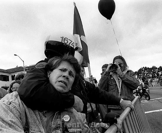 Police arrest man at Gulf War celebration parade.<br />