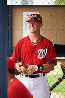 GCL Nationals shortstop Carter Kieboom (9) smiles in the dugout after hitting a home run during a game against the GCL Astros on August 14, 2016 at the Carl Barger Baseball Complex in Viera, Florida.  GCL Nationals defeated GCL Astros 8-6.  (Mike Janes/Four Seam Images)