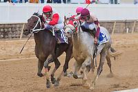 Action Andy, Horacio Karamanos up, wins the 2012 DeFrancis Dash at Laurel Park in Laurel Maryland.
