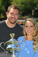 January 28, 2018: The 2018 Australian Open Women's Champion Caroline Wozniacki of Denmark and her fiancé David Lee pose for photographs with her trophy at the Botanical Gardens in Melbourne, Australia. Photo Sydney Low
