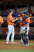 Palm Beach Cardinals pitcher Junior Fernandez (10) fist bumps Fort Myers Miracle catcher Brian Navarreto and St. Lucie Mets first baseman Jhoan Urena (41) while waiting for manager Gera Alvarez (not shown) to make a pitching change during the Florida State League All-Star Game on June 17, 2017 at Joker Marchant Stadium in Lakeland, Florida.  FSL North All-Stars  defeated the FSL South All-Stars  5-2.  (Mike Janes/Four Seam Images)