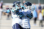 06 February 2016: North Carolina's Chris Cloutier (CAN) (right) celebrates his fifth goal of the game with Steve Pontrello (left). The University of North Carolina Tar Heels hosted the University of Michigan Wolverines in a 2016 NCAA Division I Men's Lacrosse match. UNC won the game 20-10.