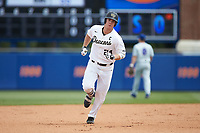 Gavin Sheets (24) of the Wake Forest Demon Deacons rounds the bases after hitting a home run against the Florida Gators in Game Two of the Gainesville Super Regional of the 2017 College World Series at Alfred McKethan Stadium at Perry Field on June 11, 2017 in Gainesville, Florida.  (Brian Westerholt/Four Seam Images)