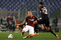 Calcio, Serie A: Roma vs Inter. Roma, stadio Olimpico, 1 marzo 2014.<br /> AS Roma midfielder Radja Nainggolan, of Belgium, left, is challenged by FC Inter defender Jorge Pires da Fonseca Rolando, of Capo Verde, during the Italian Serie A football match between AS Roma and FC Inter at Rome's Olympic stadium, 1 March 2014.<br /> UPDATE IMAGES PRESS/Riccardo De Luca