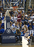 Little Rock guard Rayjon Tucker (3) dunks the ball against Nevada in the second half of an NCAA college basketball game in Reno, Nev., Friday, Nov. 16, 2018. (AP Photo/Tom R. Smedes)