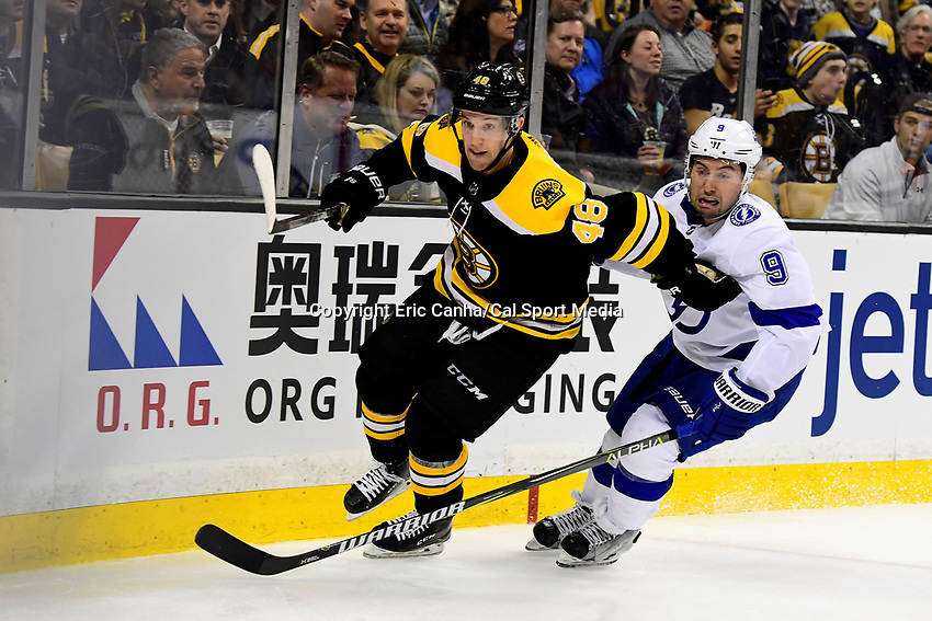 March 29, 2018: Boston Bruins defenseman Matt Grzelcyk (48) and Tampa Bay Lightning center Tyler Johnson (9) in game action during the NHL game between the Tampa Bay Lightning and the Boston Bruins held at TD Garden, in Boston, Mass. Boston defeats Tampa Bay 4-2. Eric Canha/CSM