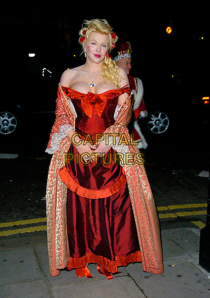 COURTNEY LOVE.Arrives at the pantomime themed fancy dress party reception for Matt Lucas & Kevin McGee following their civil partnership ceremony (wedding) earlier the same day, Banquetting House, Whitehall, London, England, .17th December 2006..full length funny costume red dress low cut cleavage hair lipstick heart painted on face cheek cardigan jacket gold.CAP/CAN.©Can Nguyen/Capital Pictures