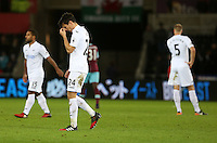 Jack Cork of Swansea City FC puts his hand to his head as he leaves the field looking dejected following the final whistle of the Premier League match between Swansea City and West Ham United at The Liberty Stadium, Swansea, Wales, UK. 26 December 2016
