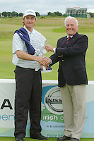 Brett Rumford Winner of the nissan Irish open Pictured with Captain Mark Varley, at the final of the Nissan Irish open in Co Louth Golf Club.Photo NEWSFILE/FRAN CAFFREY..(Photo credit should read FRAN CAFFREY/NEWSFILE)...This Picture has been sent you under the condtions enclosed by:.Newsfile Ltd..the Studio,.Millmount Abbey,.Drogheda,.Co Meath..Ireland..Tel: +353(0)41-9871240.Fax: +353(0)41-9871260.GSM: +353(0)86-2500958.email: pictures@newsfile.ie.www.newsfile.ie.FTP: 193.120.102.198..This picture is from Fran Caffrey@newsfile.ie