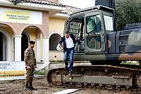 Matteo Salvini wearing an helmet, gets out the scraper after starting the demolition<br /> Matteo Salvini con il caschetto esce dalla ruspa dopo l'avvio della demolizione<br /> Roma 26/11/2018. Demolizione di una villa del clan malavitoso della famiglia Casamonica alla Romanina, Roma est. I Casamonica sono associati al crimine nella periferia sud est di Roma.<br /> Rome November 26th 2018. Another Casamonica mobster clan villa being demolished. Army started the demolition of an illegally built villa belonging to members of the Casamonica criminal clan.  The Casamonica family has been associated with crime in the south-eastern quarters of Rome for several decades.<br /> Foto Samantha Zucchi Insidefoto