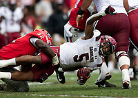 ATHENS, GA - OCTOBER 12: Rico Dowdle #5 of the South Carolina Gamecocks is tackled by Monty Rice #32 of the Georgia Bulldogs during a game between University of South Carolina Gamecocks and University of Georgia Bulldogs at Sanford Stadium on October 12, 2019 in Athens, Georgia.