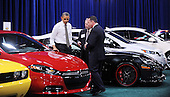 United States President Barack Obama looks at cars during a visit to the DC Auto Show at the Walter E. Washington Convention Center in Washington, DC on January 31, 2012. .Credit: Olivier Douliery / Pool via CNP