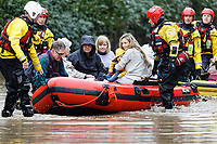 Pictured: A young mother clutches her baby while being evacuated by the fire service in Nantgarw, Wales, UK. Sunday 16 February 2020<br /> Re: Residents from Oxford Street in the village of Nantgarw had to be evacuated in inflatable boats by the Fire Service after rover Taff burst its banks in south Wales, UK.
