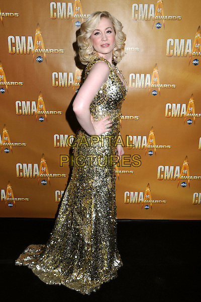 KELLIE PICKLER .44th Annual CMA Awards, Country Music's Biggest Night, held at Bridgestone Arena, Nashville, Tennessee, USA, 10th November 2010..CMAs country music full length gold sequined sequin long maxi sleeveless long maxi dress  hand on hip side .CAP/ADM/LF.©Laura Farr/AdMedia/Capital Pictures.