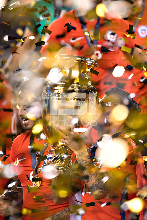 Photo during the awards ceremony after the match Argentina vs Chile, Corresponding to Great Final of the America Centenary Cup 2016 at Metlife Stadium, East Rutherford, New Jersey.<br /> <br /> <br /> Foto durante la ceremonia de premiacion despues del partido Argentina vs Chile, correspondiente a la Gran Final de la Copa America Centenario 2016 en el  Metlife Stadium, East Rutherford, Nueva Jersey, en la foto: Mark Gonzalez levanta el trofeo de campeon de Chile<br /> <br /> <br /> 26/06/2016/MEXSPORT/David Leah.