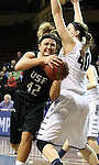 SIOUX FALLS, SD - MARCH 3:  Amber Paden #42 from the University of Sioux Falls spins to the basket against Anika Whiting #40 from Concordia St. Paul in the first half of their semifinal game of the NSIC Tournament Monday night at the Sanford Pentagon. (Photo by Dave Eggen/Inertia)