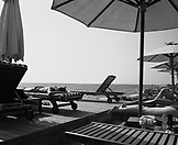 SRI LANKA, Asia, Colombo, people sunbathing at Galle Face hotel (B&W)