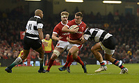 Wales Jarrod Evans is tackled by Barbarians Andre Esterhuizen<br /> <br /> Photographer Ian Cook/CameraSport<br /> <br /> 2019 Autumn Internationals - Wales v Barbarians - Saturday 30th November 2019 - Principality Stadium - Cardifff<br /> <br /> World Copyright © 2019 CameraSport. All rights reserved. 43 Linden Ave. Countesthorpe. Leicester. England. LE8 5PG - Tel: +44 (0) 116 277 4147 - admin@camerasport.com - www.camerasport.com
