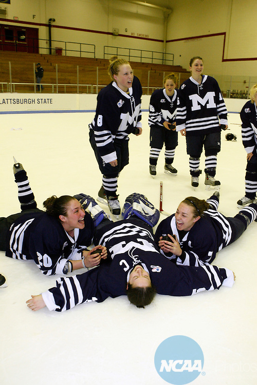 18 Mar 2006. Middlebury College's womens hockey team celebrate their first place victory in the NCAA Division lll Championship game Saturday night at SUNY Plattsburgh in upstate New York. Middlebury defeated Plattsburgh State 3-1 in the championship game. The game was held in the Stafford Arena.Laying on the ice are (L-R) Gloria Velez,#20, goalie Kate Kogut, and Liz Yale-Loehr,#7. Nancie Battaglia/NCAA Photos