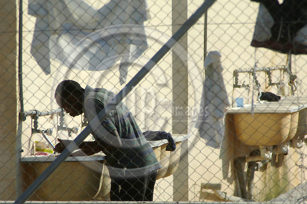 "VALETTA - MALTA 21. JULY 2006 -- African immigrants at Malta.  At Lyster Barracks detention centre in Hal Far near Malta International Airport. The camp has basic facilities...This image is delivered according to terms set out in ""Terms - Prices & Terms"". (Please see www.eup-images.com for more details)"