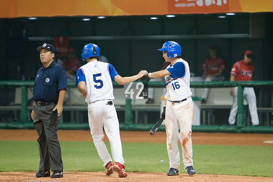 20 August 2007: #5 Kenji Hagiwara is congratulated by #16 Florian Peyrichou as he scores during the Czech Republic 6-1 victory over France in the Good Luck Beijing International baseball tournament (olympic test event) at the Wukesong Baseball Field in Beijing, China.
