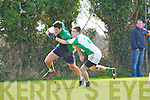 Churchill's Benny Dillon and Na Gaeil's Ross Culloty in action in the Junior Club Football Championship at The Spa on Sunday.